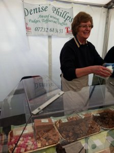 Denise Phillips at her stand presenting toffee, fudge and truffles to the customers