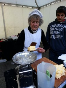 Mary demonstrates her skills in traditional butter making