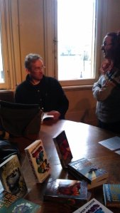 Jasper Fforde signing book at the end of the meeting