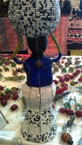 The Kotwa artists can make anything using the wire and beads. among the animals, we have seen cars and people figurines. Here you can see a figure of a lady carring traditional backet on her head