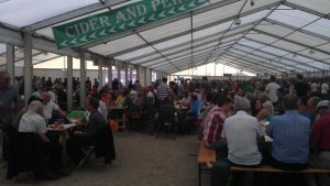 Visitors resting in the main tent at the festival