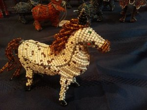Zebra or a horse made  from especially polished beads and  artistic wire