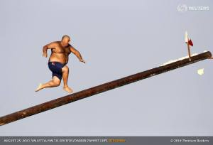 "August 25, 2013 - Daniel Caruana (aka ""Gostra Man"") takes part in the gostra competition in the village of St Julians, Malta"