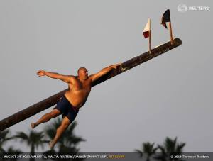 "August 24, 2013 - Daniel Caruana (aka ""Gostra Man"") takes part in the gostra competition in the village of St Julians, Malta"