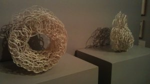 Nest I by Wendy Houghton (on the left) with another artwork in the background - priced at £450