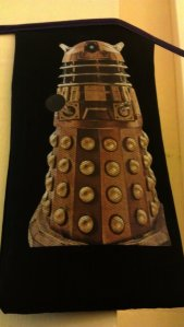 An image of Super Dalek on decorative bunting in the main corridor of Shire Hall