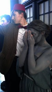 Weeping Angel covers her face and the Eleventh Doctor