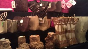 Handmade leather purses and traditional Nepali drum EleFair trade stall