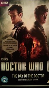 "Picture of our copy of ""The Day of the Doctor"" with  sticker  advertising the  mini episode starring Paul McGann"