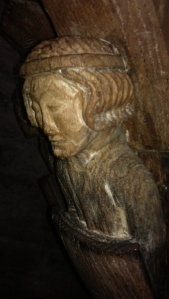 A wooden sculpture of an angel  decorating the pulpit