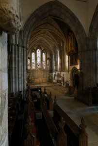 Brecon Cathedral - A view looking east showing the choir and chancel with the cathedra by the south column of the crossing.  Photography by R.J.L Smith. Used with permission