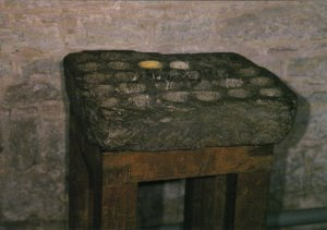 Brecon Cathedral - The Cresset Stone - a medieval vessel to contain flammable material to provide light. Photography by R.J.L Smith. Used with permission