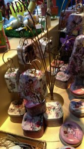 Tree decorated with chocolates tins