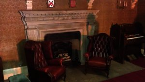 Fire place and two Victorian chairs placed in the middle of the staircase - perfect observation point
