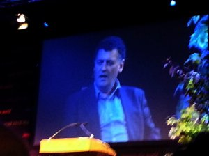 Steven Moffat on the screen inside TATA tent