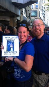 Monica and Bill showing off pictures from their Doctor Who inspired wedding