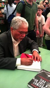 Mukesh Kapila signing our book