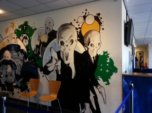 "Second mural located by the ticket office - The Silence, Ood kind and Sontarans - Strax and Staal from ""The Sontaran Stratagem"""