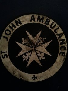 St Jon Ambulance logo on TARDIS door - we have always been curious how the logo looked like in detail