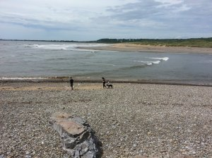 The beach at Ogmore has a sandy part but majority of the coast is covered by stones