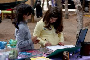 Children drawing during 2013 workshop we organized during Earth Festival. Photo my own.