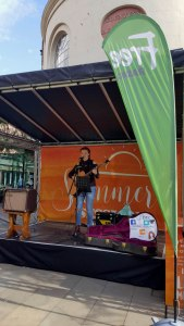 Young artist Amie sings on a stage located at the CrownGate Shopping complex in Worcester