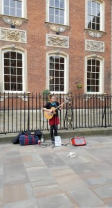 Poppy WS sings in from of Guildhall in Worcester High Street