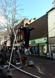 Unnamed tightrope walker performs in Worcester. This man tours the country from Manchester to Wales.